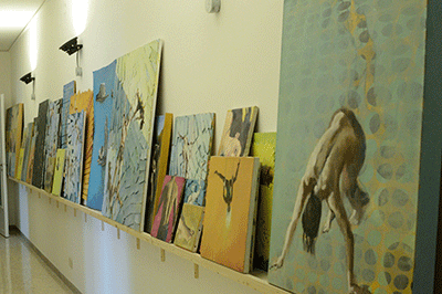 Shelf of paintings in Studio
